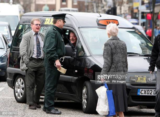 Police talk to taxi drivers who are protesting in Belfast city centre over the lack of taxi ranks