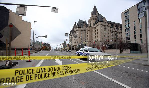 Police tape blocks Wellington St at Sussex near the National War Memorial where a soldier was shot earlier in the day just blocks away from...