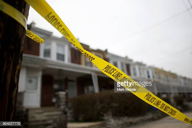 Police tape blows in the wind near the scene of a shooting ambush last night of 33yearold Police Officer Jesse Hartnett who was shot 13 times at...