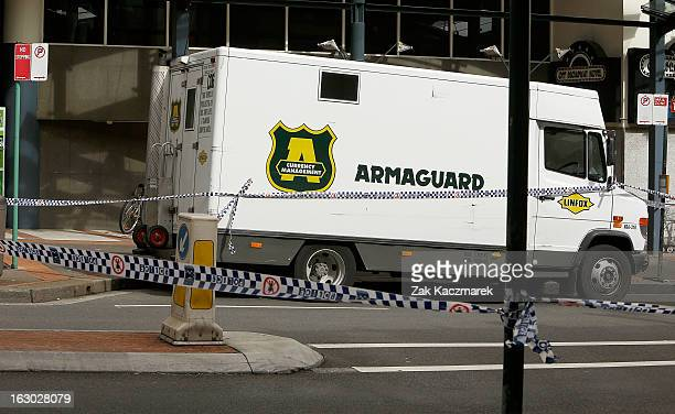 Police tape cordons off an Armuguard vehicle on Bay Street Broadway on March 4 2013 in Sydney Australia Shots were reportedly fired at an Armaguard...