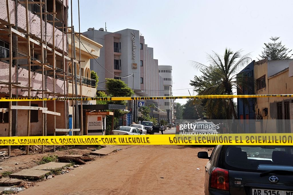 Police tape cordons off the street of the Radisson Blu hotel in Bamako on November 21 a day after the deadly jihadist siege at the luxury hotel...