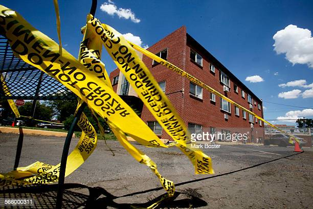 Police tape flutters in the breeze while prosecution teams continue to investigate the apartment complex in Auroroa Colorado where mass shooting...