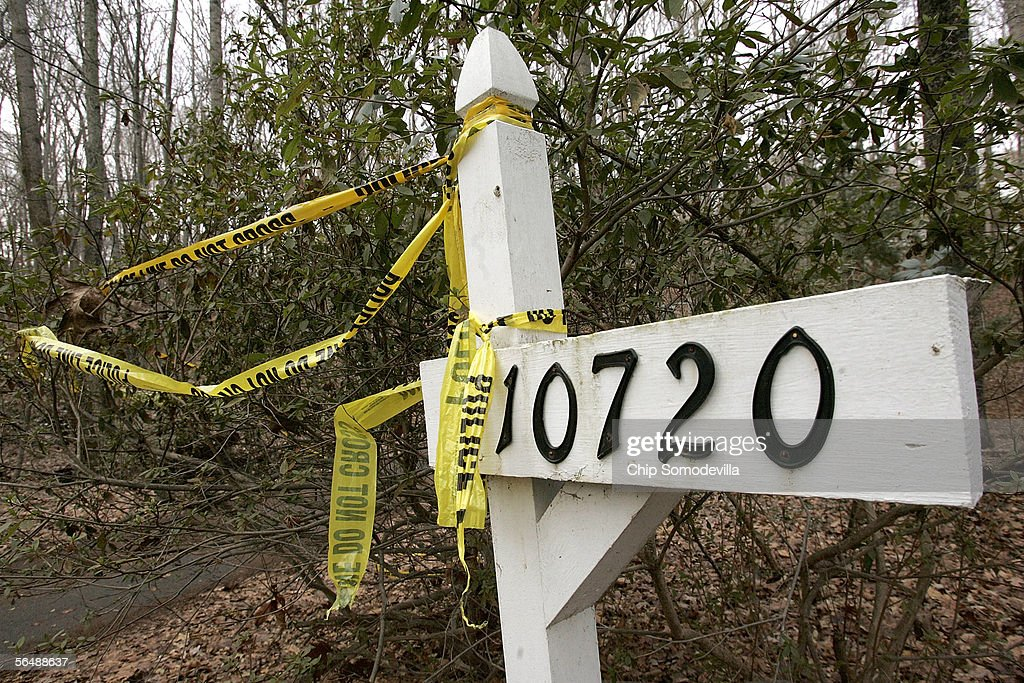 Police tape hangs from the address marker of the house at 10720 Sycamore Springs Lane December 26 2005 in Great Falls Virginia A 27yearold man...