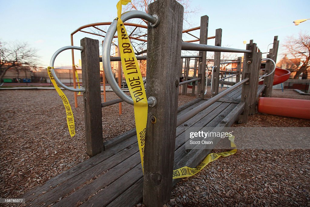 Police tape hangs from the playground equipment where 16-year-old Jeffrey Stewart collapsed after being shot on December 9, in the Humboldt Park neighborhood on the city's West Side December 28, 2012 in Chicago, Illinois. Stewart was shot about a block away then ran to the playground where he collapsed. He was shot with 17-year-old Anton Reed who survived with a gunshot wound to the hand. Reed was later arrested after vomiting three baggies of what appeared to be cocaine. Chicago has had about 500 murders this year. Today after news organizations began reporting about what was believed to be the 500th murder the Chicago Police Department's News Affairs Office issued a statement stating Chicago's murder total remains at 499 because classification of one death investigation remains pending. They would not specify which death is pending. The total number of murders in the city has only once exceeded 500 victims since 2004. The murder rate is up about 11 percent from 2011, much of which is attributed to growing gang violence.