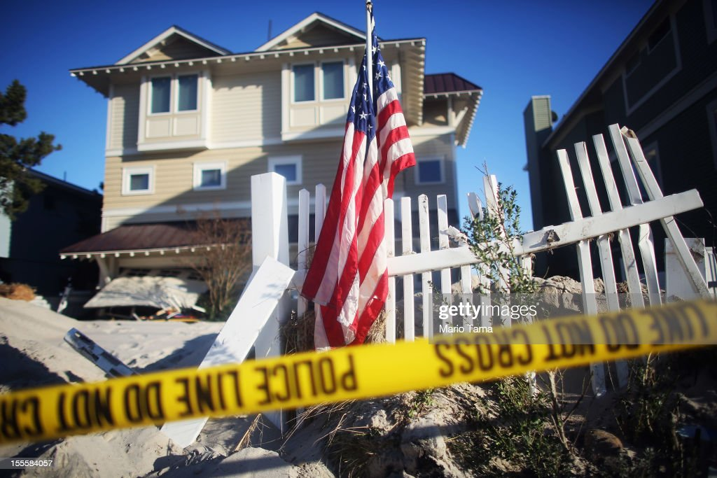 Police tape hangs in front of a home damaged by Superstorm Sandy on November 5, 2012 in Beach Haven, New Jersey. Today was the first day residents were allowed to return to Long Beach Island following the storm.