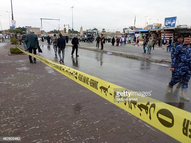 Police tape is hung near the site where a suicide bomber detonated explosives inside a restaurant in Baghdad alJadida east of the capital on February...