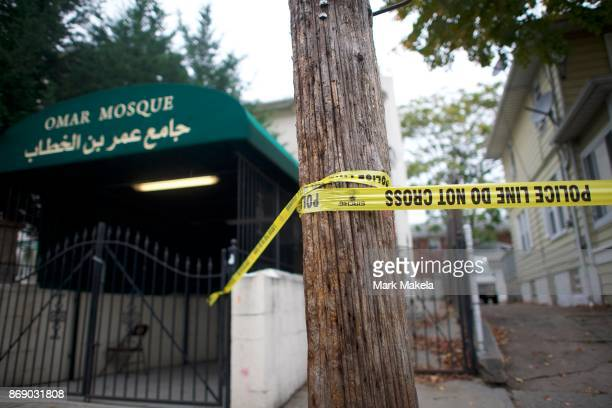 Police tape is placed beside the Omar Mosque to block a rear entrance to the residence of Sayfullo Saipov the suspect who drove a pickup truck on a...
