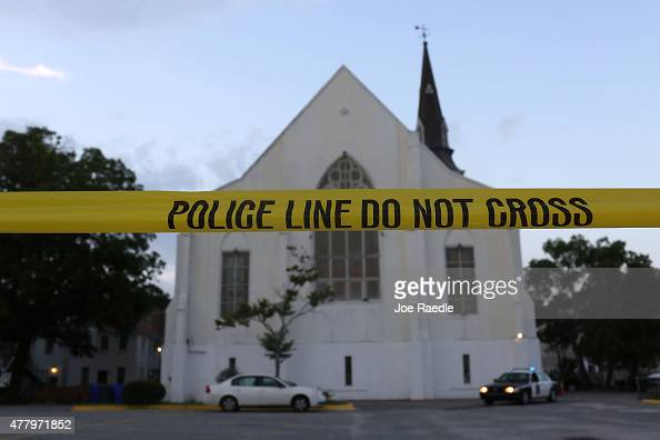 Police tape is seen near the Emanuel African Methodist Episcopal Church before it is opened for a Sunday service after a mass shooting at the church...