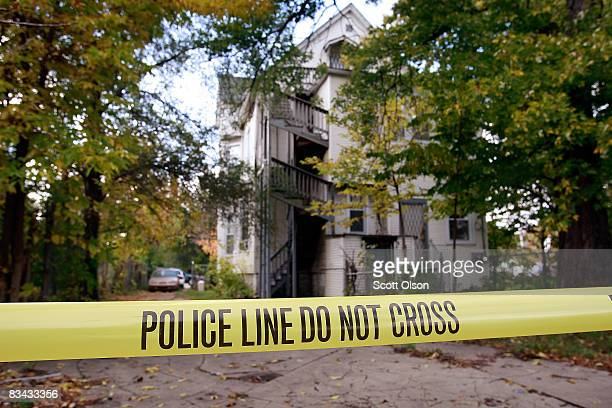 Police Tape is stretched around the outside of the home of 57yearold Darnell Hudson Donerson the mother of Oscar winner Jennifer Hudson October 25...