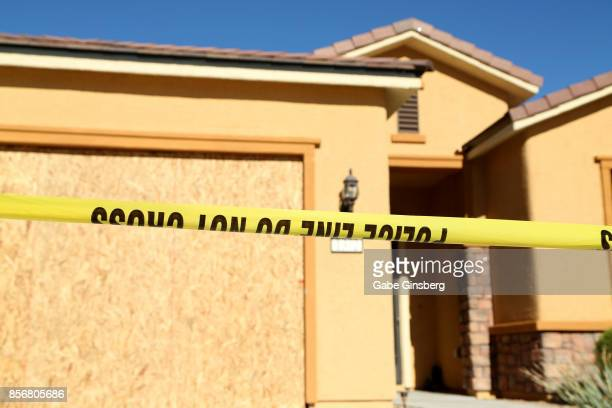 Police tape lines the driveway in front of the house in the Sun City Mesquite community where suspected Las Vegas gunman Stephen Paddock lived...