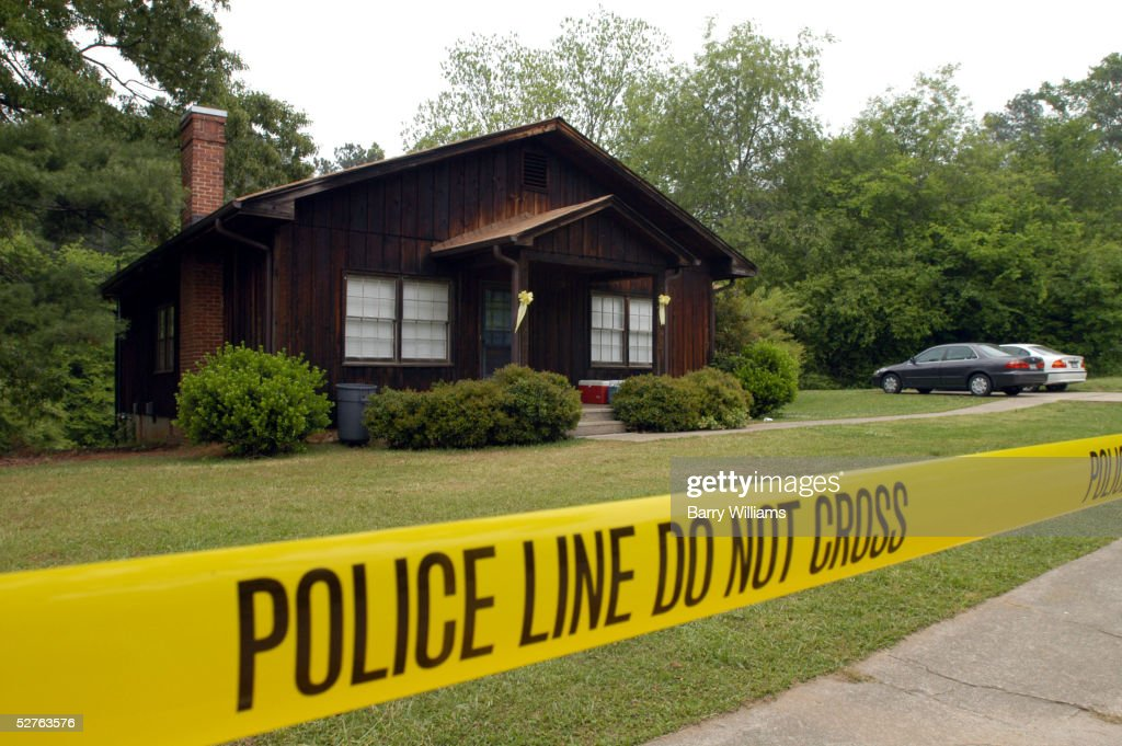 Police tape lines the outside of the house of John Mason the fiance of the runaway bride Jennifer Wilbanks in Duluth Georgia Jennifer Wilbanks...
