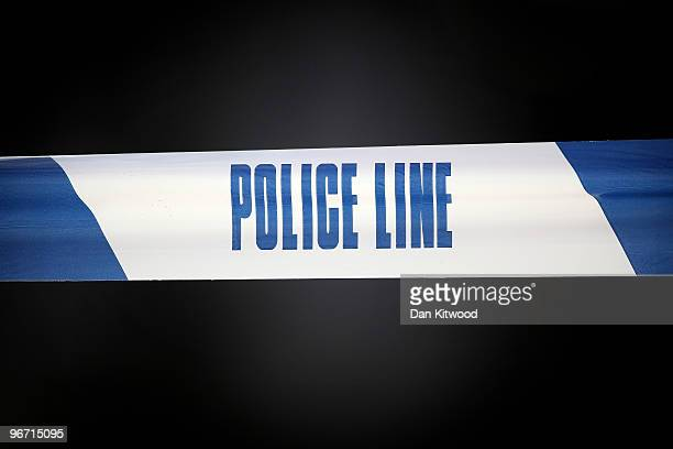 Police tape marks off an area where a man was stabbed and killed in South Norwood on February 15 2010 in London United Kingdom As the UK gears up for...
