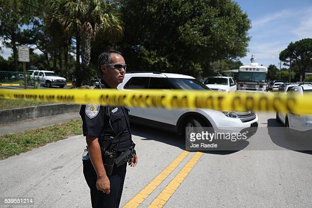 Police tape marks off the entrance to the apartment building where shooting suspect Omar Mateen is believed to have lived on June 12 2016 in Fort...