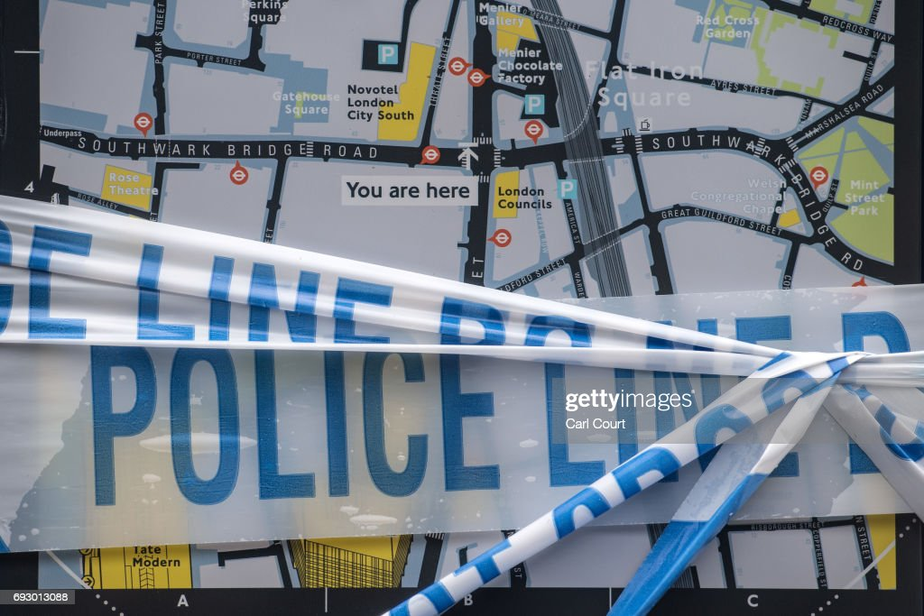 Police tape partly covers a tourist direction sign near London Bridge following Saturday's terrorist attack, on June 6, 2017 in London, England. The third attacker has been named following the attack on Saturday night in London Bridge and Borough in which seven people were killed and forty eight injured.
