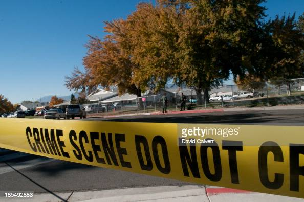Police tape secures the scene after a shooting at Sparks Middle School October 21 2013 in Sparks Nevada A staff member was killed and two students...