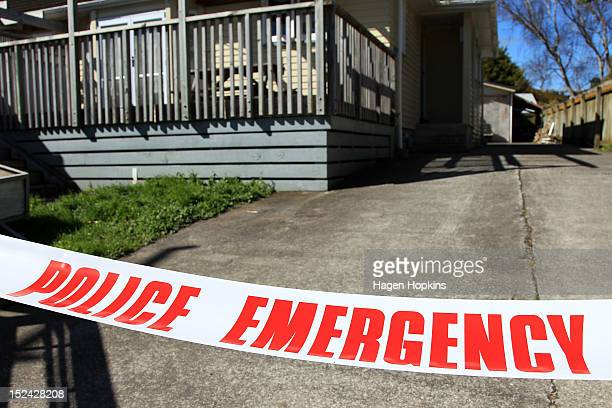 Police tape surrounds a scene associated with a suspicious death at another property on Farmer Crescent on September 21 2012 in Lower Hutt New...