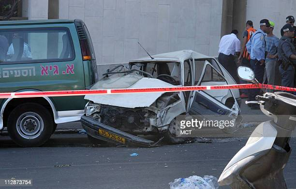 Police tape surrounds one of the cars crushed by a Palestinian attacker driving a construction backhoe on Tuesday July 22 2008 on the road leading to...