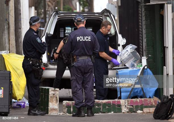 Police tape up evidence outside a house in the inner Sydney suburb of Surry Hills on July 30 after it was raided in a major joint counterterrorism...