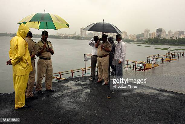 police team from Powai stands at the lake after the body of 45yearold Prabhu Gawandkar drowned inspite of being a good swimmer