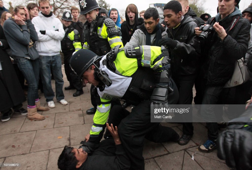 Police tried to hold back students who were trying to occupy a Bristol University building as they took part in a protest over the Government's budget cuts and proposed rise in tuition fees on November 30, 2010 in Bristol, England. Hundreds of students demonstrated in the second major protest of its kind in Bristol in as many weeks. Protests are also being staged in London, Liverpool, Leeds, Manchester, Edinburgh and Sheffield.