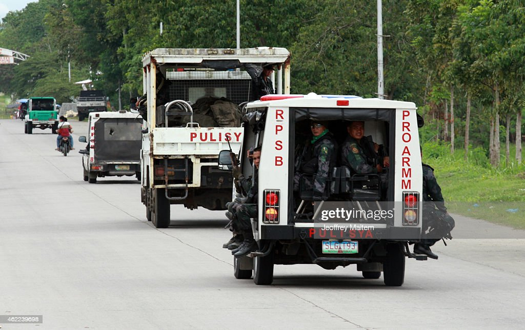 A police truck carrying the bodies of comrades passes the national highway during a retrieval operation on January 26, 2015 in Mamasapano, Maguindanao Province, Philippines. Dozens of elite policemen were killed after a clash with a Muslim rebel group. Lawmen were trying to serve arrest warrants on January 25, 2015 for criminals led by Malaysian bomb maker Zulkifli bin Hir, known in military and police officials as Marwan, when the group clashed with the guerillas under Commander Guiawan of Bangsamoro Islamic Freedom Fighters, a breakaway group of the Moro Islamic Liberation, the countrys largest rebel group engaged in peace talks with Manila. The death toll of government fatalities in the fierce firefight reached fifty.