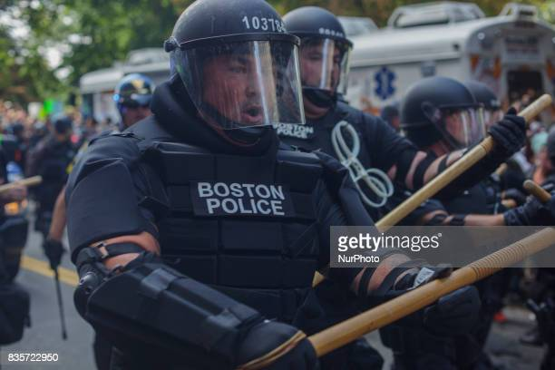 Police try to block counterprotesters of the 'Free Speech' Rally on August 19 in Boston Thousands of antiracism demonstrators flooded the streets of...