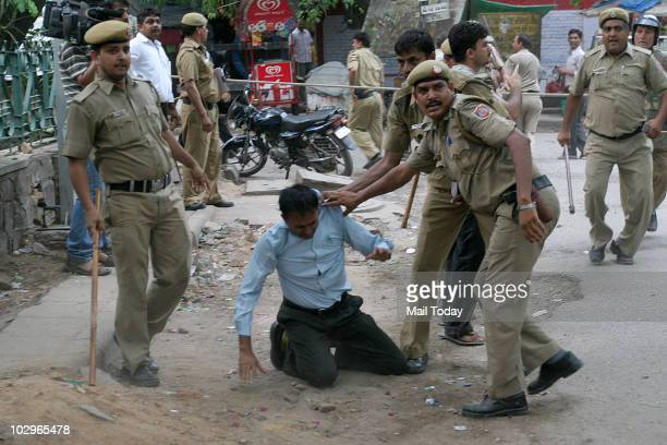 Police try to control the mob which was protesting against a Headlines Today sting linking RSS leaders with terror strikes at the office of the news...