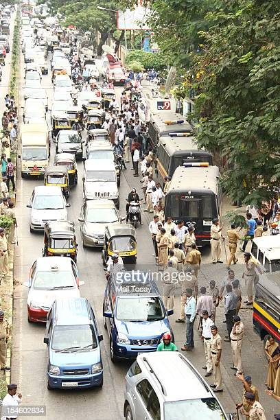 Police try to control traffic as bollywood celebrities arrive at YRF studio to pay their last respects to Yash Chopra in Mumbai on 22nd October 2012