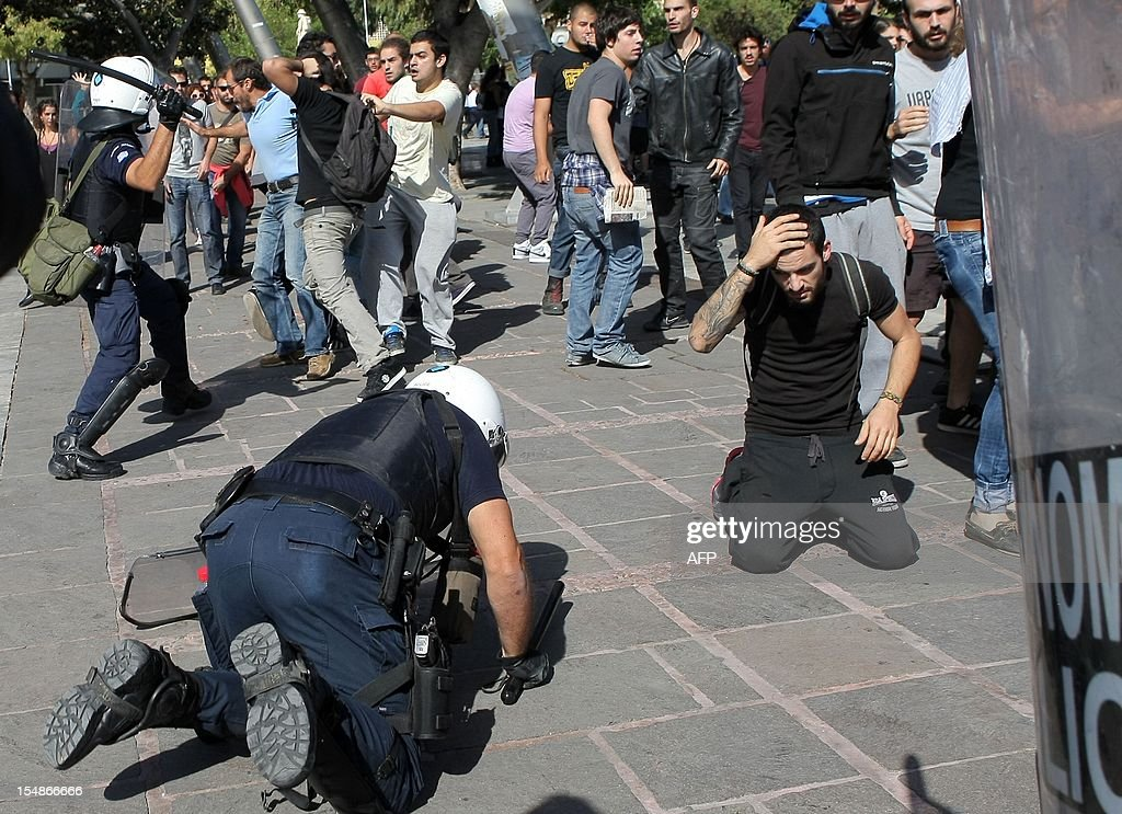 Police try to disperse protesters in Heraklion on the southern Greek island of Crete on October 28, 2012 during a student parade marking the annual celebrations of the National No Day, commemorating Greece's refusal to surrended to Italian dictator Benito Mussolini's invading troops in 1940. AFP PHOTO/ Costas Metaxakis