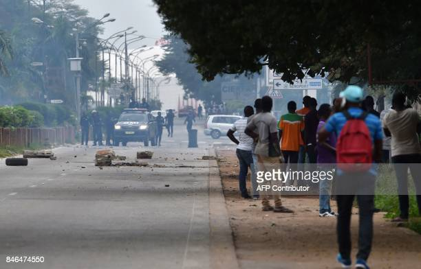 Police try to disperse students near a university campus in the Cocody district in Abidjan on September 13 following clashes between police forces...