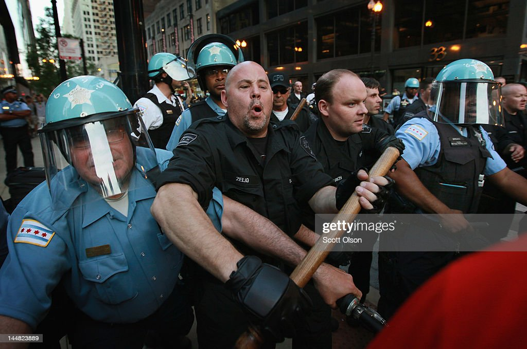 Police try to keep demonstrators from breaking through their lines durijng a march through the downtown streets on May 19, 2012 in Chicago, Illinois. This was the sixth day of protests in front of the NATO Summit which runs May 20-21.