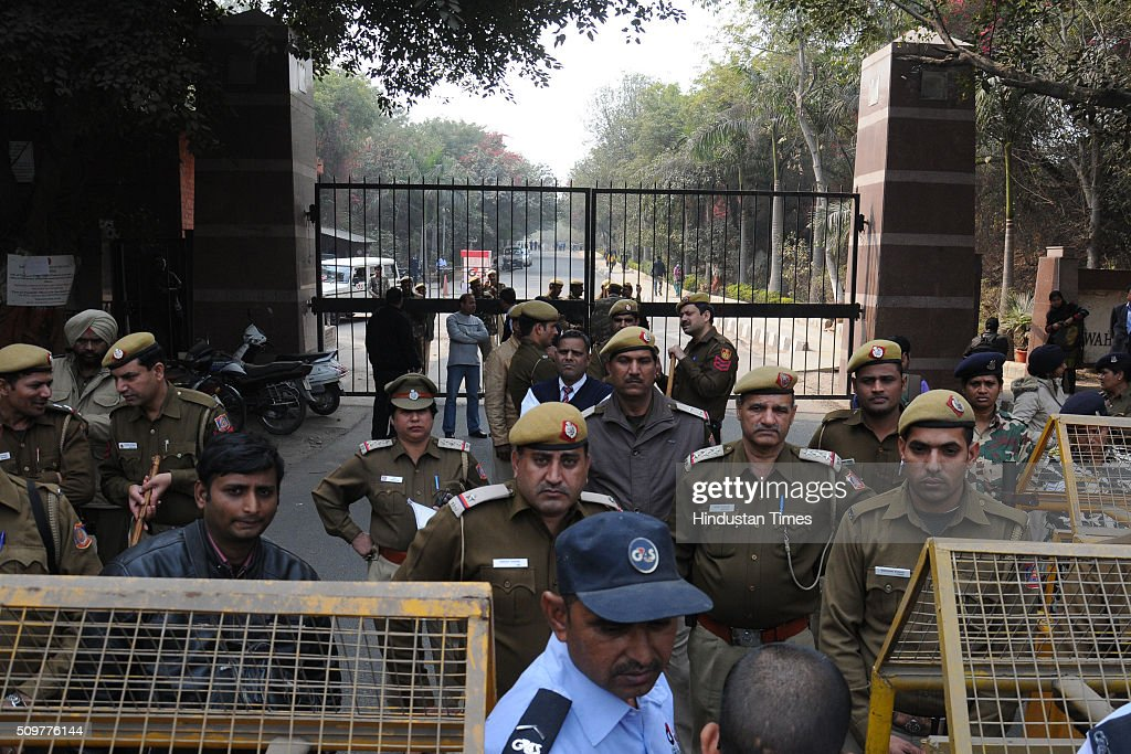 Police trying to stop residents of nearby Munirka Village during demonstration against the organisers of the event on Afzal Guru where slogans were anti-national slogans were raised at JNU Campus on February 12, 2016 in New Delhi, India. JNU students union president Kanhaiya Kumar was arrested on in connection with a case of sedition and criminal conspiracy over holding of an event at the prestigious institute against hanging of Parliament attack convict Afzal Guru in 2013. A group of students on Tuesday held an event on the JNU campus and allegedly shouted slogans against India.