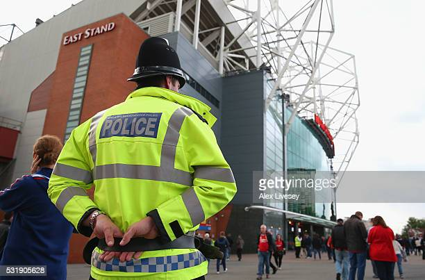 Police units patrol outside Old Trafford prior to the Barclays Premier League match between Manchester United and AFC Bournemouth at Old Trafford on...