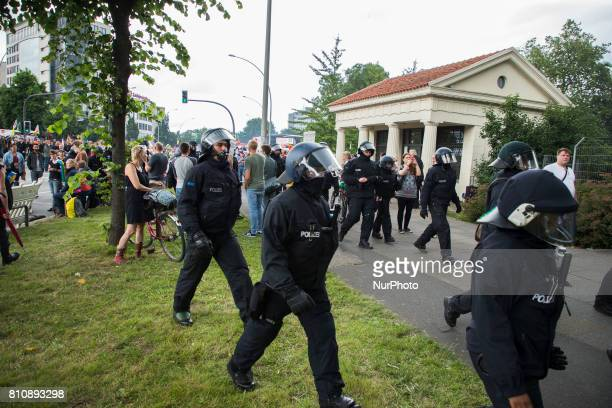 Police units stand guard during a protest march against the G20 Summit with the topic 'Solidarity without borders instead of G20' in Hamburg Germany...