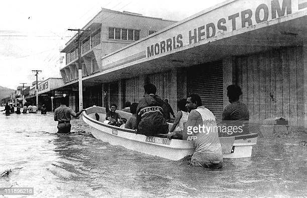 Police use a boat to patrol the main street of Labasa on Viti Levu Fiji which were devastated by cyclone Ami 15 January 2003 Ami which was packing...
