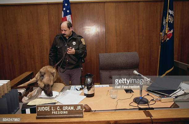 Police use a bomb sniffing dog to check the courtroom used in the Jeffrey Dahmer murder trial in Milwaukee Due to the high profile and disturbing...