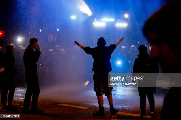 Police use a water cannon during an anti G20 protest in the red wing 'Schanzenviertel' prior to the G20 Summit in Hamburg on July 4 2017 in Hamburg...