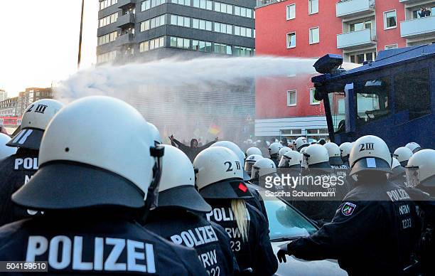 Police use a water cannon to control supporters of Pegida Hogesa and other rightwing populist groups as they protest against the New Year's Eve sex...