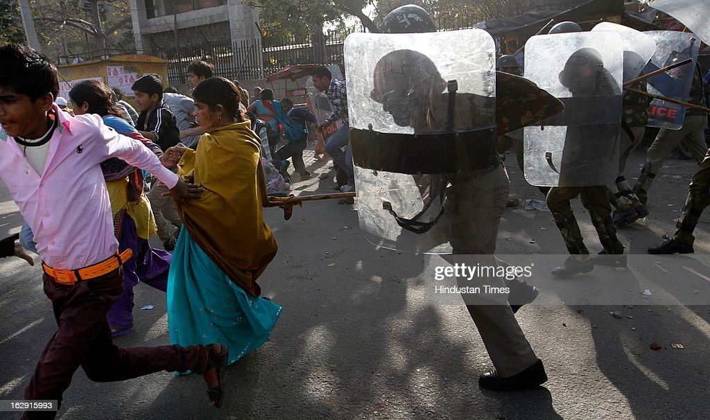 Police use baton to disperse crowd at Sanjay Gandhi hospital as people ransacked the hospital during a protest after an eight-year-old girl, student of Class 2, was allegedly raped inside the premises of a North Delhi Municipal Corporation school at Mangolpuri Area on March 1, 2013 in New Delhi, India.