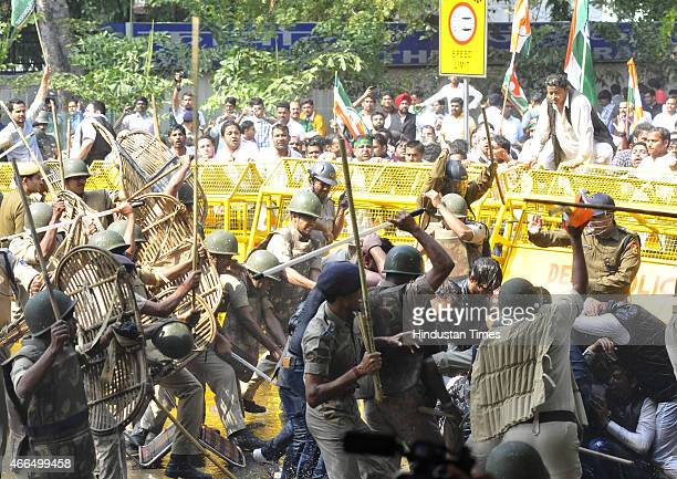 Police use lathi charge to disperse Youth Congress workers during a protest against the Land Acquisition bill at Jantar Mantar on March 16 2015 in...
