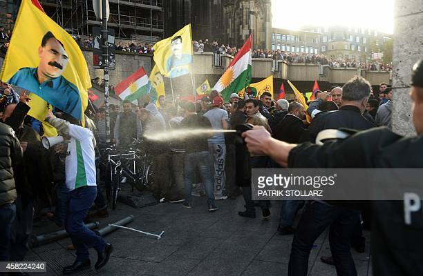 Police use pepper spray against a ProKurdish demonstration in Cologne western Germany on November 1 2014 as part of an international day in support...