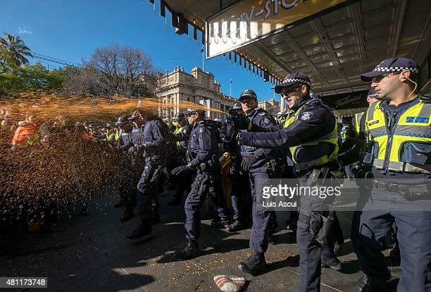 Police use pepper spray on anti 'Reclaim Australia' protesters during a rally on July 18 2015 in Melbourne Australia 'Reclaim Australia' grassroots...