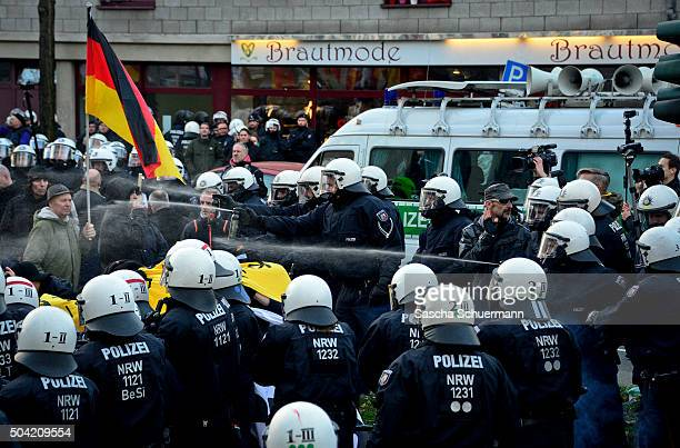 Police use pepper spray to control supporters of Pegida Hogesa and other rightwing populist groups as they protest against the New Year's Eve sex...