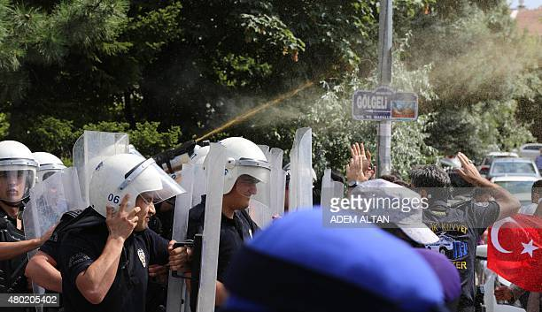 Police use pepper spray to prevent the breach of a barricade by Uighur seperatist supporters during a demonstration outside the Chinese embassy in...