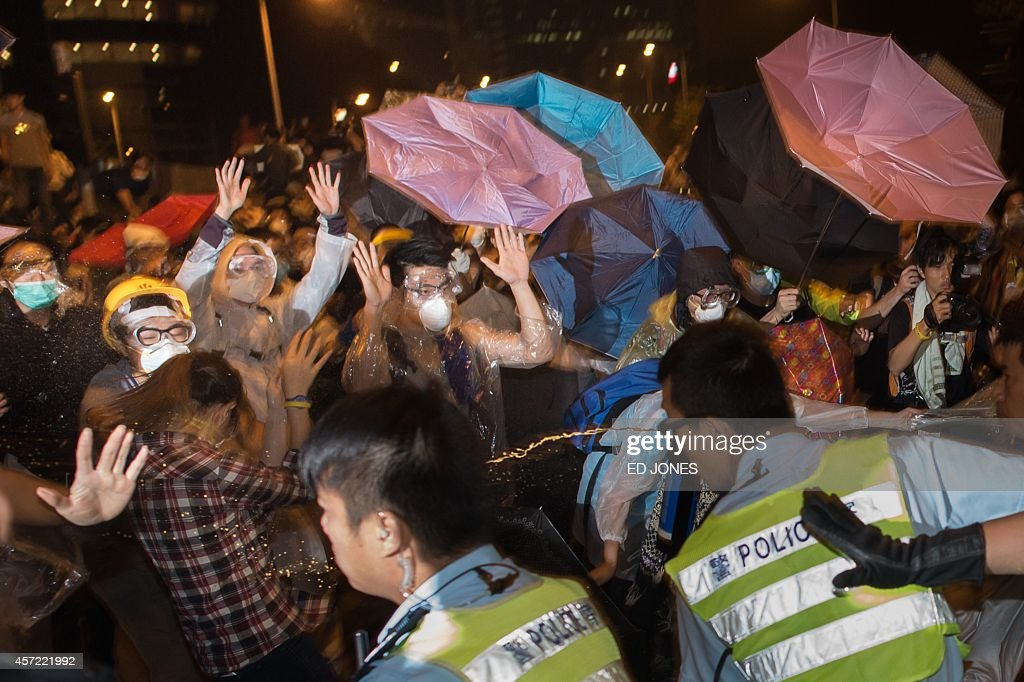 Police use pepperspray on prodemocracy protesters during a confrontation outside the central government offices in the Admiralty district of Hong...