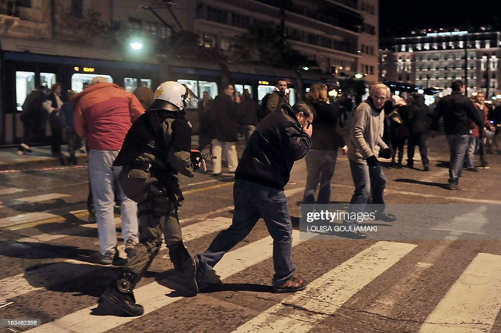 Police use tear gas to disperse gathering demonstrators from in front of the Greek parliament in Athens on March 10, 2013. Greece's 'Indignants' gathered at Syntagma Square in front of the parliament under a ' banner', 'Poverty, unemployment, suicides. Enough is enough!', following the example of Portugal, which held a similar protest on March 2 .