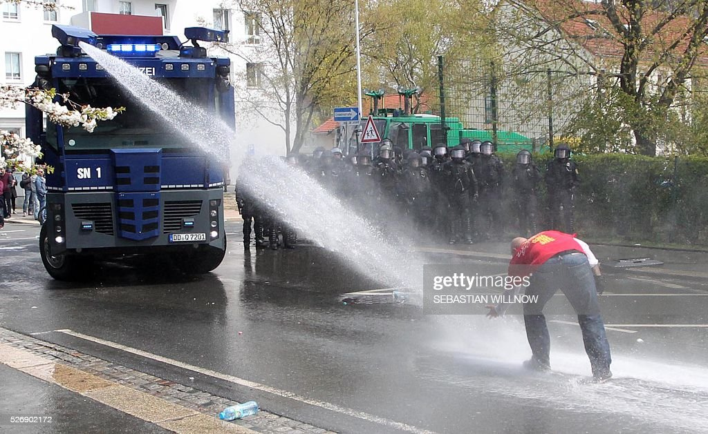 Police use water cannon against participants of a farright demonstration in Plauen, eastern Germany on May 1, 2016. / AFP / dpa / Sebastian Willnow / Germany OUT