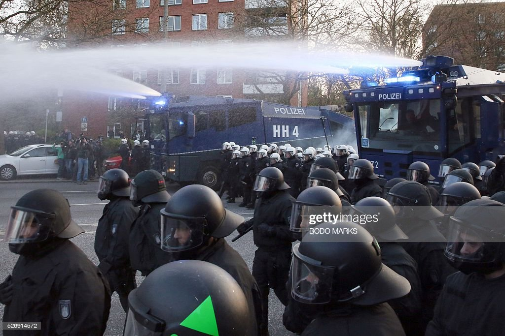 Police use water cannon against people taking part in the traditional 'Revolutionary' May Day demonstration in Hamburg, northern Germany, on May 1, 2016. Thousands of leftists, trade unionists and workers took to the streets through out the country on the occasion of International labour day. / AFP / dpa / Bodo Marks / Germany OUT