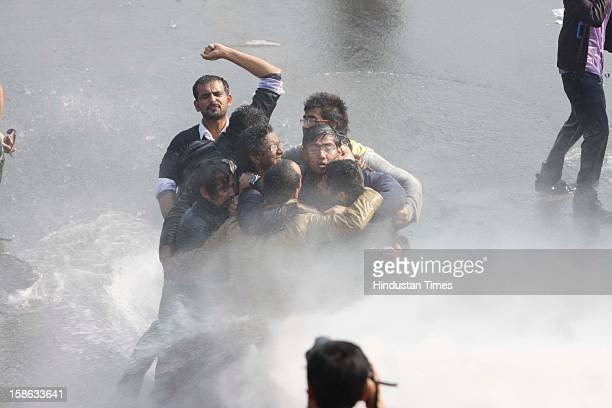 Police use water cannon and tear gas to control demonstrators during a protest at Vijay Chowk following a brutal gang rape of 23 year Para medical...