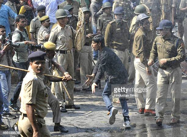 Police use water cannon to disperse Youth Congress workers during a protest against the Land Acquisition bill at Jantar Mantar on March 16 2015 in...